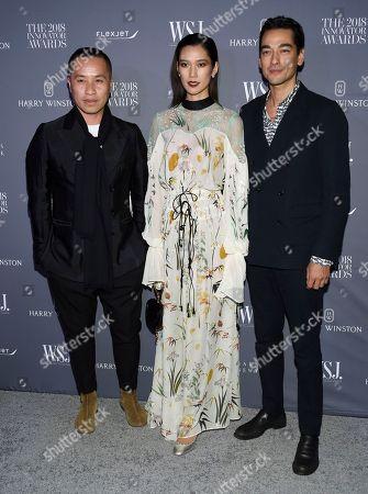 Stock Image of Phillip Lim, Tao Okamoto, Tenzin Wild. Phillip Lim, left, Tao Okamoto and Tenzin Wild attend the WSJ Magazine 2018 Innovator Awards at the Museum of Modern Art, in New York