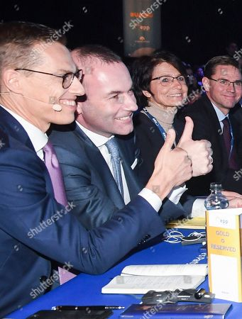 German MEP Manfred Weber (2-L) and Finland's former Prime Minister Alexander Stubb (L) give the thumbs up during the 23rd European People's Party (EPP) Congress in Helsinki, Finland, 08 November 2018. European conservative centre-right parties gathered in Helsinki on 07 and 08 November, to elect the lead candidate for the next European elections that will take place from 23 to 26 May 2019. Top candidates are German MEP Manfred Weber and Finland's former Prime Minister Alexander Stubb.