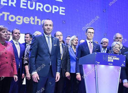 German MEP Manfred Weber (C) and Finland's former Prime Minister Alexander Stubb (C-R) join hands as they attend the 23rd European People's Party (EPP) Congress in Helsinki, Finland, 08 November 2018. European conservative centre-right parties gathered in Helsinki on 07 and 08 November, to elect the lead candidate for the next European elections that will take place from 23 to 26 May 2019. Top candidates are German MEP Manfred Weber and Finland's former Prime Minister Alexander Stubb. In picture at left is seen German Chancellor Angela Merkel.