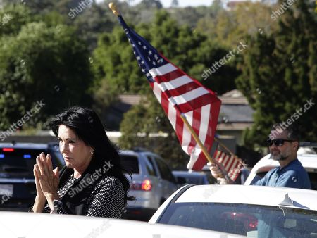 Kary Lloyd (L) prays and Kevin Kane (R) holds a US flag as the hearse carrying the body of Sergeant Ron Helus passes by in Thousand Oaks, California, USA, 08 November 2018. 13 people were killed and several wounded in the mass shooting at the Borderline Bar & Grill. A sheriff's deputy, 11 attendees and the gunmen were killed.