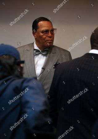 """Minister Louis Farrakhan, the leader of the Nation of Islam, stands prior to start his press conference in Tehran, Iran, . Farrakhan warned President Donald Trump not to pull """"the trigger of war in the Middle East at the insistence of Israel."""" The 85-year-old Farrakhan, long known for provocative comments widely considered anti-Semitic, criticized the economic sanctions leveled by Trump against Iran after his pullout from the nuclear deal"""