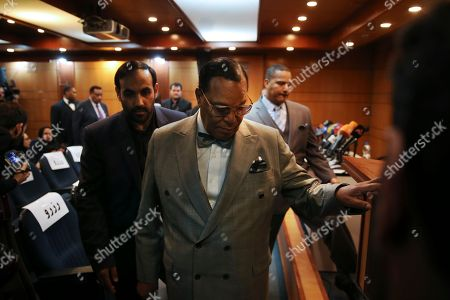 """Minister Louis Farrakhan, the leader of the Nation of Islam, arrives to his press conference, in Tehran, Iran, . Farrakhan warned President Donald Trump not to pull """"the trigger of war in the Middle East, at the insistence of Israel."""" The 85-year-old Farrakhan, long known for provocative comments widely considered anti-Semitic, criticized the economic sanctions leveled by Trump against Iran after his pullout from the nuclear deal"""
