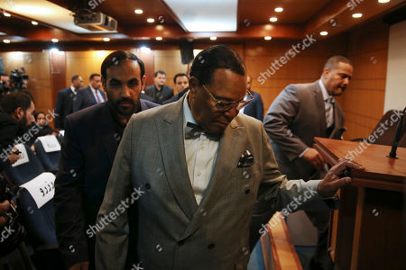 """Minister Louis Farrakhan, the leader of the Nation of Islam, arrives to his press conference in Tehran, Iran, . Farrakhan warned President Donald Trump not to pull """"the trigger of war in the Middle East, at the insistence of Israel."""" The 85-year-old Farrakhan, long known for provocative comments widely considered anti-Semitic, criticized the economic sanctions leveled by Trump against Iran after his pullout from the nuclear deal"""