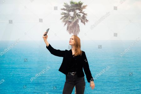 Sarah taking a selfie with Palm tree and seascape