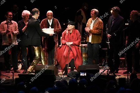 Joni Mitchell is presented with a birthday cake