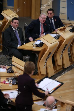 Stock Picture of Scottish Parliament First Minister's Questions - Miles Briggs, Jackson Carlaw, Deputy Leader of the Scottish Conservative and Unionist Party, stands in for Ruth Davidson, Leader of the Scottish Conservative and Unionist Party, who is on maternity leave, Maurice Goden, listen to Nicola Sturgeon, First Minister of Scotland and Leader of the Scottish National Party (SNP).