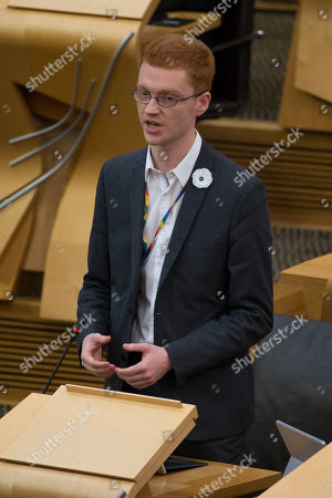 Scottish Parliament First Minister's Questions - Ross Greer wears a white Peace Poppy