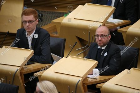Stock Image of Scottish Parliament First Minister's Questions - Ross Greer and Patrick Harvie, Co-convener of the Scottish Greens,Êwear white Peace Poppies