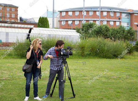 Stock Image of Pictured : (l-r) Olivia Lichtenstein with cameraman Kieran Carruthers in the grounds of Broadmoor