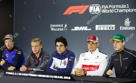 Drivers attend a press conference ahead of Sunday's Formula One Brazilian Grand Prix, at the Interlagos racetrack, in Sao Paulo, Brazil, . Pictured are Toro Rosso's Brendon Hartley of New Zealand, from left, Haas' Kevin Magnussen of Denmark, Williams' Martini Racing Lance Stroll of Canada, Sauber's Marcus Ericsson of Sweden, and McLaren's Stoffel Vandoorne of Belgium
