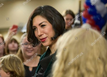 Democratic gubernatorial candidate Paulette Jordan talks with supporters at an election night party, in Boise, Idaho
