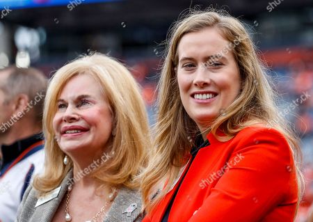 Brittany Bowlen, right, daughter of Denver Broncos owner Pat Bowlen, and Anabel Bowlen, left, wife of owner Pat Bowlen smile prior to an NFL football game against the Houston Texans, in Denver