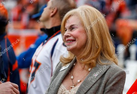 Annabel Bowlen, wife of Denver Broncos owner Pat Bowlen smiles on the sidelines prior to an NFL football game between the Denver Broncos and the Houston Texans, in Denver