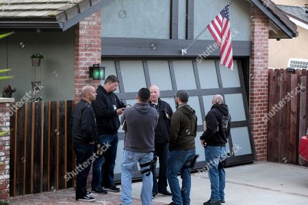 Ventura County Sheriff's deputies stand outside the house of shooting suspect David Ian Long in Newbury Park, Calif., on . Authorities said the former Marine opened fire at a country music bar in Southern California on Wednesday evening