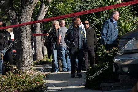 FBI investigators arrive outside the house of David Ian Long, the identified shooter in Wednesday's attack on a country music bar in Southern California, as they wait to search the residence, in Newbury Park, Calif. Using a smoke bomb and a handgun, the former Marine opened fire during college night at the Borderline Bar & Grill, killing multiple people and sending hundreds fleeing in panic before apparently taking his own life, authorities said Thursday. Authorities said the motive for the attack was under investigation