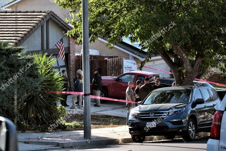 Ventura County Sheriff's deputies and FBI investigators stand outside the house of shooting suspect David Ian Long in Newbury Park, Calif., on . Authorities said the former Marine opened fire at a country music bar in Southern California on Wednesday evening