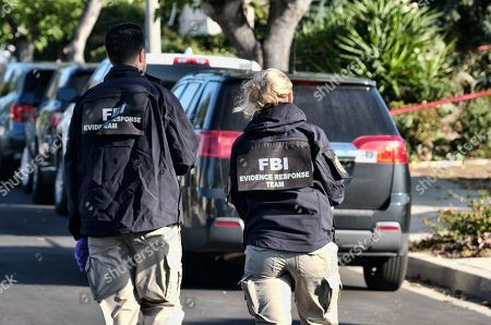 FBI investigators arrive outside the house of shooting suspect David Ian Long in Newbury Park, Calif., on . Authorities said the former Marine opened fire at a country music bar in Southern California on Wednesday evening