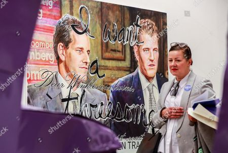 A woman looks at a piece of art by US artist Christine Wang depicting US twins Cameron and Tyler Winklevoss, on display at the Independent Art Fair in Brussels, Belgium, 08 November 2018. The fair runs from 08 to 11 November.
