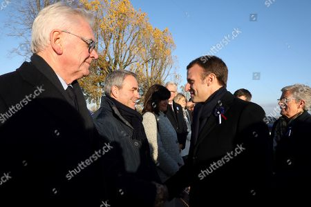 French President Emmanuel Macron (R) shakes hands with President of the Hauts-de-France regional council Xavier Bertrand (2-L) as he arrives to visit the 'Ring of Memory' international World War I memorial, at the Notre Dame de Lorette French war cemetery in Ablain-Saint-Nazaire, France, 08 November 2018. Macron is currently on a six-day tour to visit the most iconic landmarks of the First World War ahead of the celebrations of the 100th anniversary of the 11 November 1918 armistice.