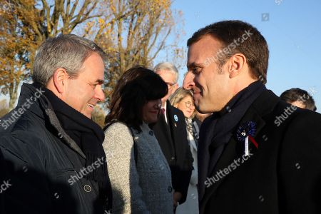 French President Emmanuel Macron (R) shakes hands with President of the Hauts-de-France regional council Xavier Bertrand (L)  as he arrives to visit the 'Ring of Memory' international World War I memorial, at the Notre Dame de Lorette French war cemetery in Ablain-Saint-Nazaire, France, 08 November 2018. Macron is currently on a six-day tour to visit the most iconic landmarks of the First World War ahead of the celebrations of the 100th anniversary of the 11 November 1918 armistice.