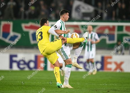 Daniele Bonera of Villarreal CF (L) in action against Andrija Pavlovic of SK Rapid Vienna (R) during the UEFA Europa League group G match between SK Rapid Vienna vs Villarreal CF in Vienna, Austria, 08 November 2018.