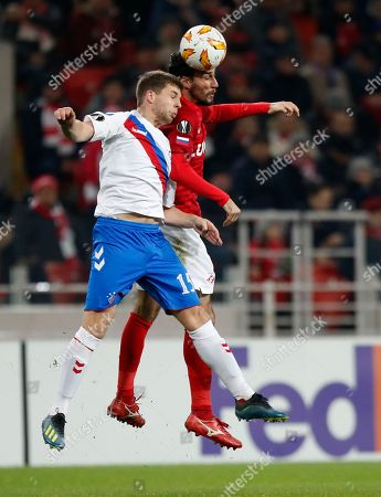 Rangers' John Flanagan, left, and Spartak's Ivelin Popov challenge for the ball during the Europa League Group G soccer match between Spartak Moscow and Rangers at the Otkrytiye Arena stadium in Moscow, Russia