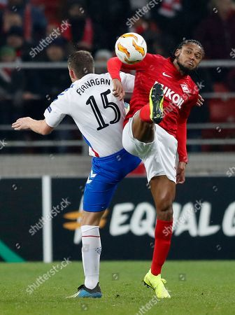 Spartak's Luiz Adriano, right, and Rangers' John Flanagan, back to a camera, challenge for the ball during the Europa League Group G soccer match between Spartak Moscow and Rangers at the Otkrytiye Arena stadium in Moscow, Russia