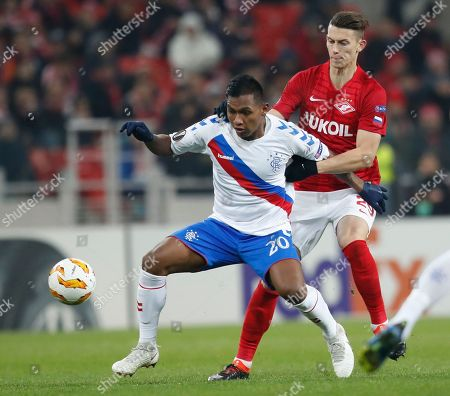 Rangers' Alfredo Morelos, left, and Spartak's Ilya Kutepov challenge for the ball during the Europa League Group G soccer match between Spartak Moscow and Rangers at the Otkrytiye Arena stadium in Moscow, Russia