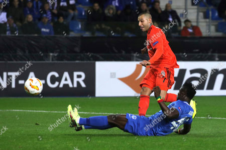 Besiktas Ricardo Quaresma, top, shoots the ball to score his side's first goal past Genk's Joseph Aidoo during the Europa League Group I soccer match between KRC Genk and Besiktas at the KRC Genk Arena in Genk, Belgium