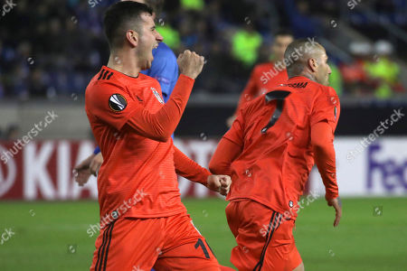 Besiktas' Ricardo Quaresma, right, celebrates with teammate Oguzhan Ozyakup after scoring the opening goal during the Europa League Group I soccer match between KRC Genk and Besiktas at the KRC Genk Arena in Genk, Belgium