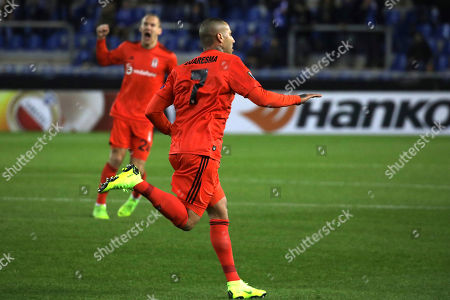 Besiktas' Ricardo Quaresma celebrates after scoring the opening goal during the Europa League Group I soccer match between KRC Genk and Besiktas at the KRC Genk Arena in Genk, Belgium