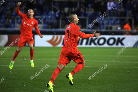 Besiktas' Ricardo Quaresma, front, celebrates after scoring the opening goal during the Europa League Group I soccer match between KRC Genk and Besiktas at the KRC Genk Arena in Genk, Belgium