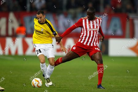 Olympiakos' Yaya Toure, right, tries to stop Dudelange's Edisson Jordan during a Group F Europa League soccer match between Olympiakos and Dudelange at Georgios Karaiskakis stadium in the port of Piraeus, near Athens