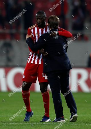 Stock Photo of Olympiakos' coach Pedro Martins, right, hugs Yaya Toure after a Group F Europa League soccer match between Olympiakos and Dudelange at Georgios Karaiskakis stadium in the port of Piraeus, near Athens, . Olympiakos won 5-1