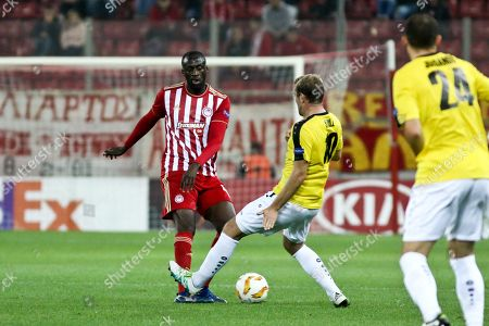 Stock Photo of Yaya Toure (L) of Olympiacos in action against Dominik Stolz of F91 Dudelange during the UEFA Europa League soccer match between Olympiacos Piraeus and F91 Dudelange at the Karaiskakis Stadium in Piraeus, Greece, 08 November 2018.