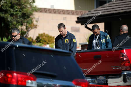 Stock Image of FBI agents leave the house of shooting suspect David Ian Long after conducting a search in Newbury Park, Calif., on . Authorities said the former Marine opened fire at a country music bar in Southern California on Wednesday evening