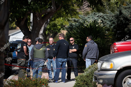 Investigators gather outside the house of shooting suspect David Ian Long in Newbury Park, Calif., on . Authorities said the former Marine opened fire at a country music bar in Southern California on Wednesday evening