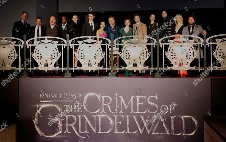 "From left, Lionel Wigram,David Heyman, David Yates,William Nadylan,Claudia Kim,Callum Turner, Zoe Kravitz, Jude Law, J.K Rowling, Eddie Redmayne,Katherine Waterston,Ezra Miller,Alison Sudol and Dan Fogler pose at the world premiere of the film ""Fantastic Beasts: The Crimes of Grindelwald"" in Paris"