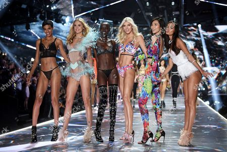 Jourdana Phillips, Megan Williams, Grace Bol, Devon Windsor, Liu Wen, Gizele Oliveira. Model Jourdana Phillips, left, Megan Williams, Grace Bol, Devon Windsor, Liu Wen and Gizele Oliveira walk the runway during the 2018 Victoria's Secret Fashion Show at Pier 94, in New York