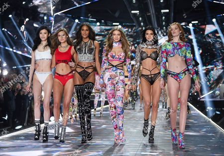 Ming Xi, Grace Elizabeth, Cindy Bruna, Gigi Hadid, Kendall Jenner, Alexina Graham. Models Ming Xi, left, Grace Elizabeth, Cindy Bruna, Gigi Hadid, Kendall Jenner and Alexina Graham walk the runway during the 2018 Victoria's Secret Fashion Show at Pier 94, in New York