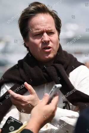 German cellist Jan Vogler speaks with journalists on the steps of the Sydney Opera House