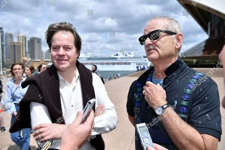 German cellist Jan Vogler (L) and US actor Bill Murray (R) speak with journalists on the steps of the Sydney Opera House