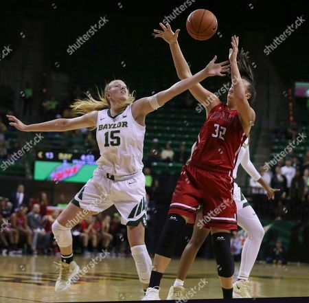Baylor forward Lauren Cox, left, blocks the shot of Saint Francis center Courtney Zezza during the first half of an NCAA college basketball game, in Waco, Texas