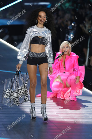 Melie Tiacoh and Bebe Rexha on the catwalk