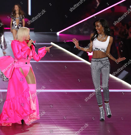 Bebe Rexha and Isilda Moreira on the catwalk