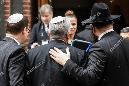 Rabbi Yehuda Teichtal (R) welcomes former German President Joachim Gauck (C) next to former Secretary of State and head of the Bundespraesidialamt David Gill (L), prior to a commemoration event at the synagogue Rykestrasse in Berlin, Germany, 09 November 2018. The year 2018 marks the 80 anniversary of the Kristallnacht, also known as Night of Broken Glass, a pogrom against the Jewish community that took place on the night from the 09 to the 10 of November 1938. SA paramilitary forces attacked, ransacked and burnt Jewish-owned stores, buildings, and synagogues throughout Germany.
