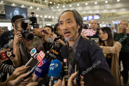 Chinese dissident author Ma Jian (C) speaks to reporters after landing at Hong Kong International Airport in Hong Kong, China, 09 November 2018. Ma's talks at Hong Kong's Tai Kwun arts centre was cancelled days after he revealed several Hong Kong publishers refused to print the Chinese version of his latest novel, which is critical of the Beijing government. Shortly before Ma landed in Hong Kong, a second venue said it would not be hosting his two events of the Hong Kong Literary Festival  events as reported.