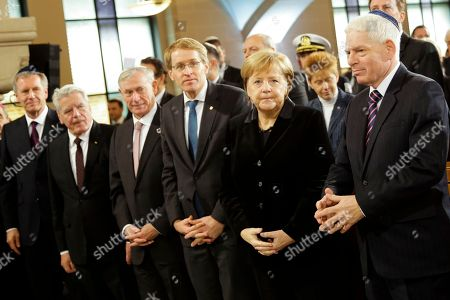 From right, the President of the Central Council of Jews in Germany Josef Schuster, German Chancellor Angela Merkel, the President of Germany's upper house Bundesrat Daniel Guenther and the former German Federal Presidents Horst Koehler, Joachim Gauck and Christian Wulff arrive at the synagogue Rykestrasse in the district Prenzlauer Berg in Berlin, to attend an event commemorating the Night of Broken Glass 1938, in which Nazis burned and vandalized synagogues and Jewish businesses across the country and killing over 400 people