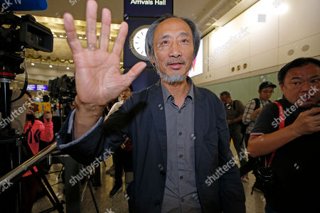"""Chinese dissident writer Ma Jian waves to media after arriving Hong Kong international airport, . Despite Mallet's rejection, Hong Kong on Friday permitted dissident writer Ma Jian to enter to attend a literary festival, even after an arts venue in the city canceled his appearance. Ma, whose novels frequently satirize China's communist leaders, told reporters he experienced nothing unusual while passing through passport control and that organizers were still lining-up a place for him to speak. """"The lecture will definitely happen. If there is a single Hong Kong person who is willing to listen, or a single reader who contacts me, I will be there,"""" Ma said"""