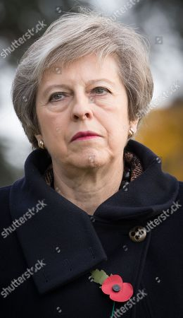 British Prime Minister Theresa May during the commemoration of the 100th anniversary of the end of the First World War at the Saint-Symphorien Military Cemetery, in Saint-Symphorien, Mons Belgium 09 November 2018. The cemetery at St. Symphorien was established by the German Army in August 1914 as the final resting place for British and German soldiers who were killed in the Battle of Mons. Among those buried here is Private John Parr of the Middlesex Regiment who was fatally wounded during an encounter with a German patrol two days before the battle, thus becoming the first British soldier to be killed in action on the Western Front. The cemetery remained in German hands until the end of the war and also contains the graves of Commonwealth and German soldiers who were killed in the final days of the conflict, including George Ellison of the Royal Irish Lancers and George Price of the Canadian Infantry. Ellison and Price were killed on Armistice Day 11 November 1918 and are believed to be the last Commonwealth casualties of the First World War. In total, there are 284 German and 230 Commonwealth casualties buried in this site.